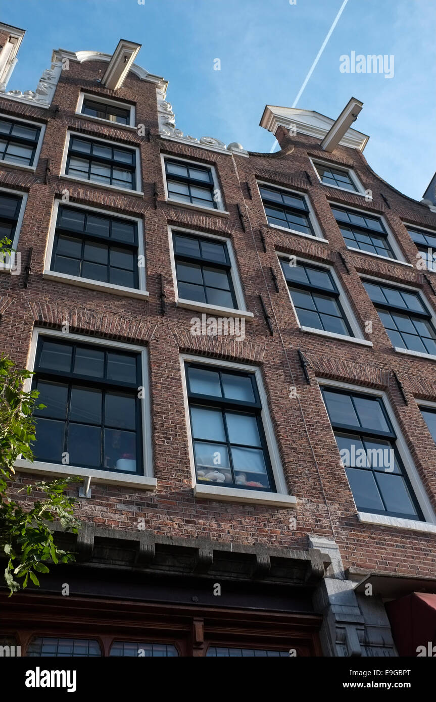 amsterdam town house roof top and windows with blue sky, amsterdam, holland, netherlands - Stock Image