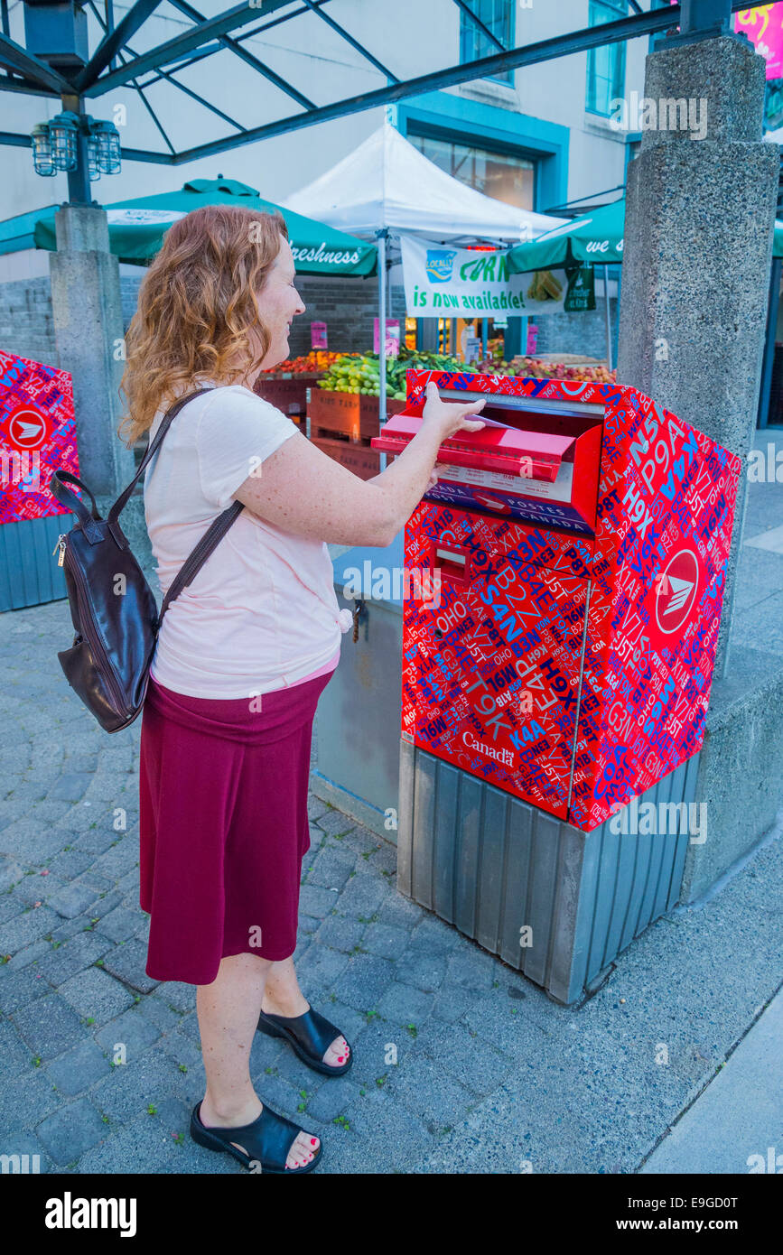 Woman posting letter in Canada - Stock Image