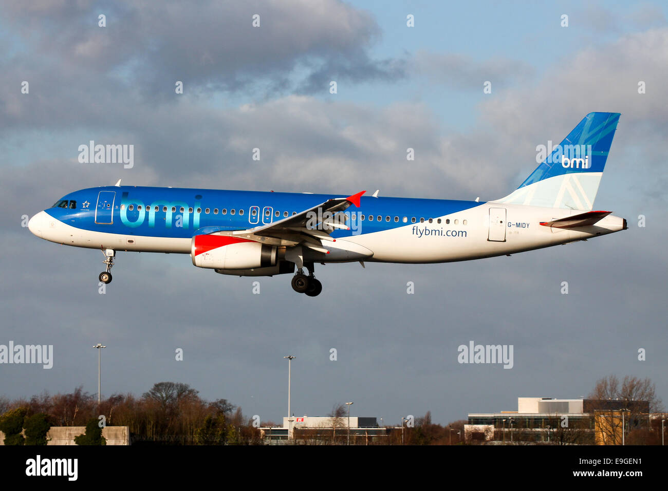bmi British Midland Airbus A320 approaches runway 23R at Manchester Airport. - Stock Image