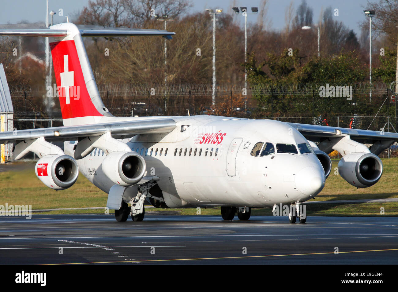 Swiss International Airlines British Aerospace RJ100 lines up on runway 23R at Manchester airport. - Stock Image
