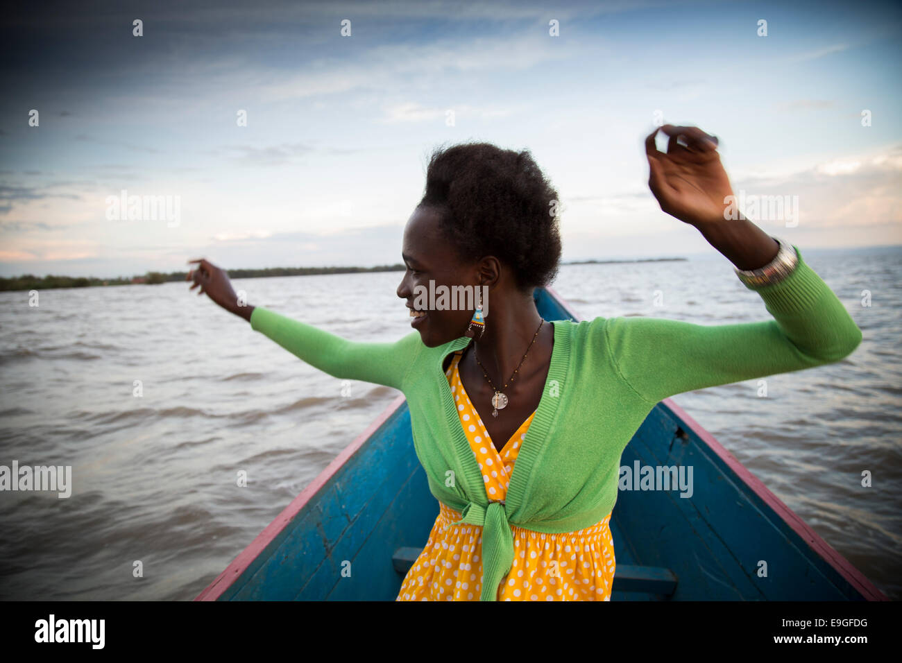 A modern young African woman having fun on Lake Victoria, near Kisumu, Kenya Stock Photo