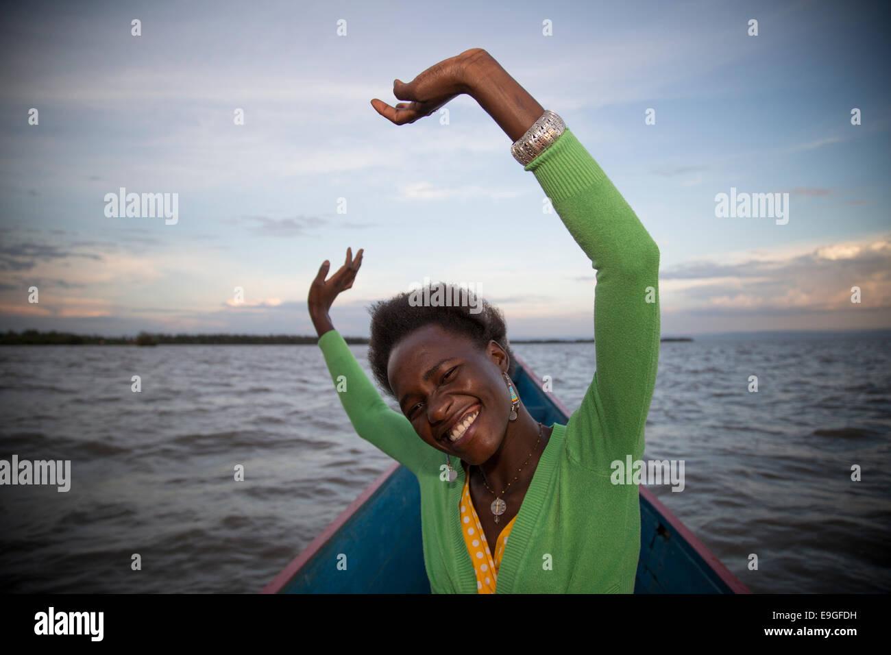 A modern young African woman having fun on Lake Victoria, near Kisumu, Kenya Stock Photo