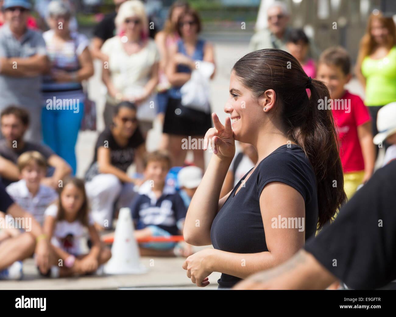 Spanish sign language interpreter at intercultural meeting in Spain - Stock Image