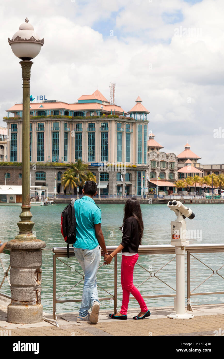 A couple at the Caudan Waterfront, a modern development in Port Louis, Mauritius Stock Photo