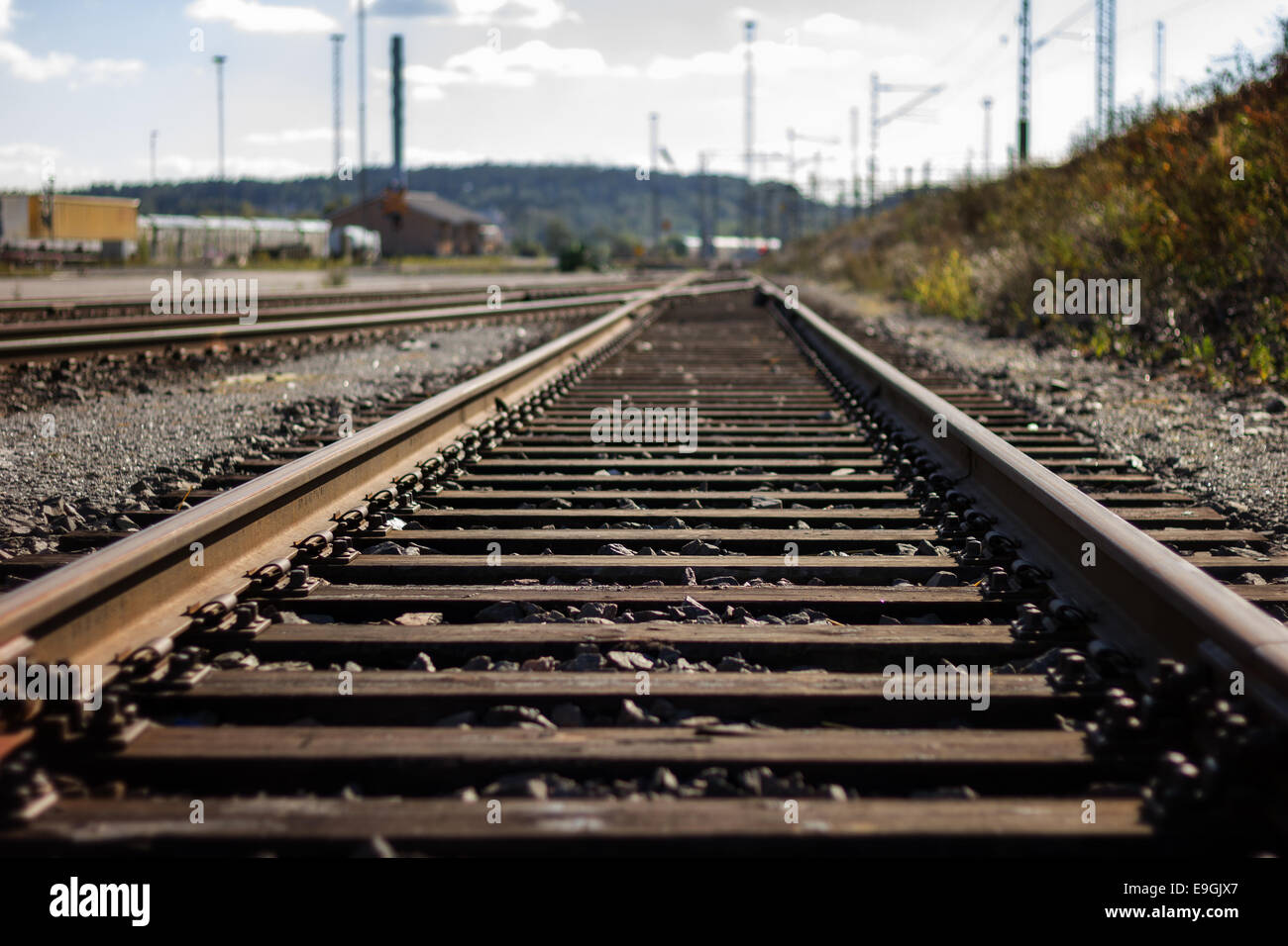 Nobody at a straight railroad track outdoors in daylight, small depth of field - Stock Image