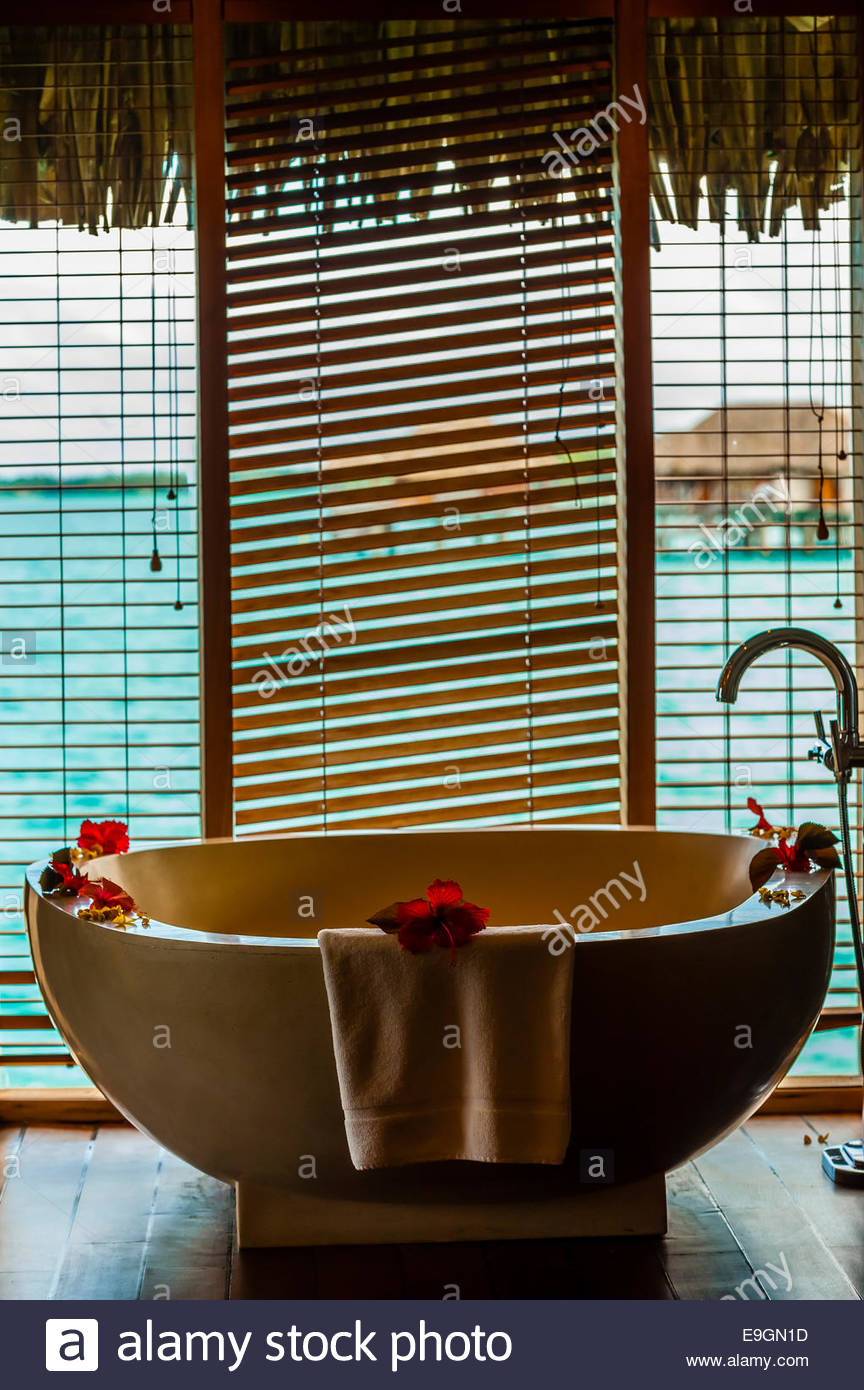 Interior view of Overwater bungalow suite with plunge pool, Four Seasons Resort Bora Bora, French Polynesia. - Stock Image