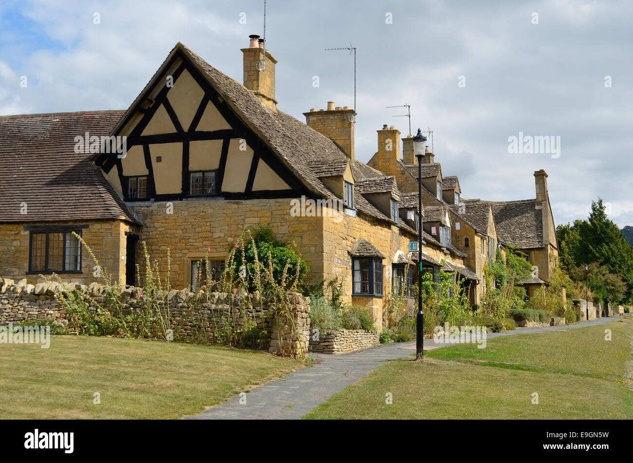 The Shakespeare's cottages, traditional half-timbered houses built out of honey-coloured stone in the town of Broadway, - Stock Image