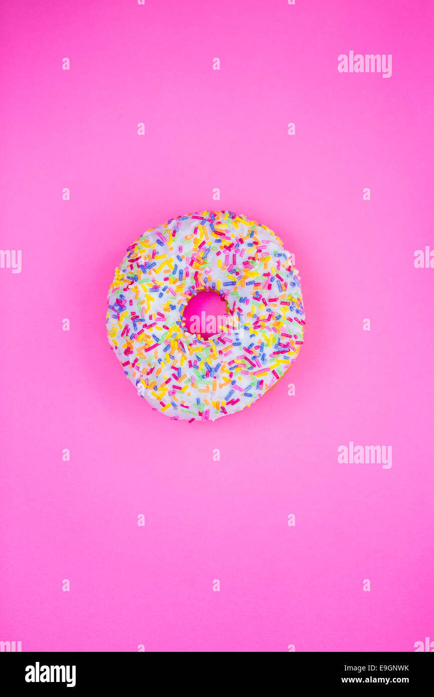 Donut on pink background - Stock Image