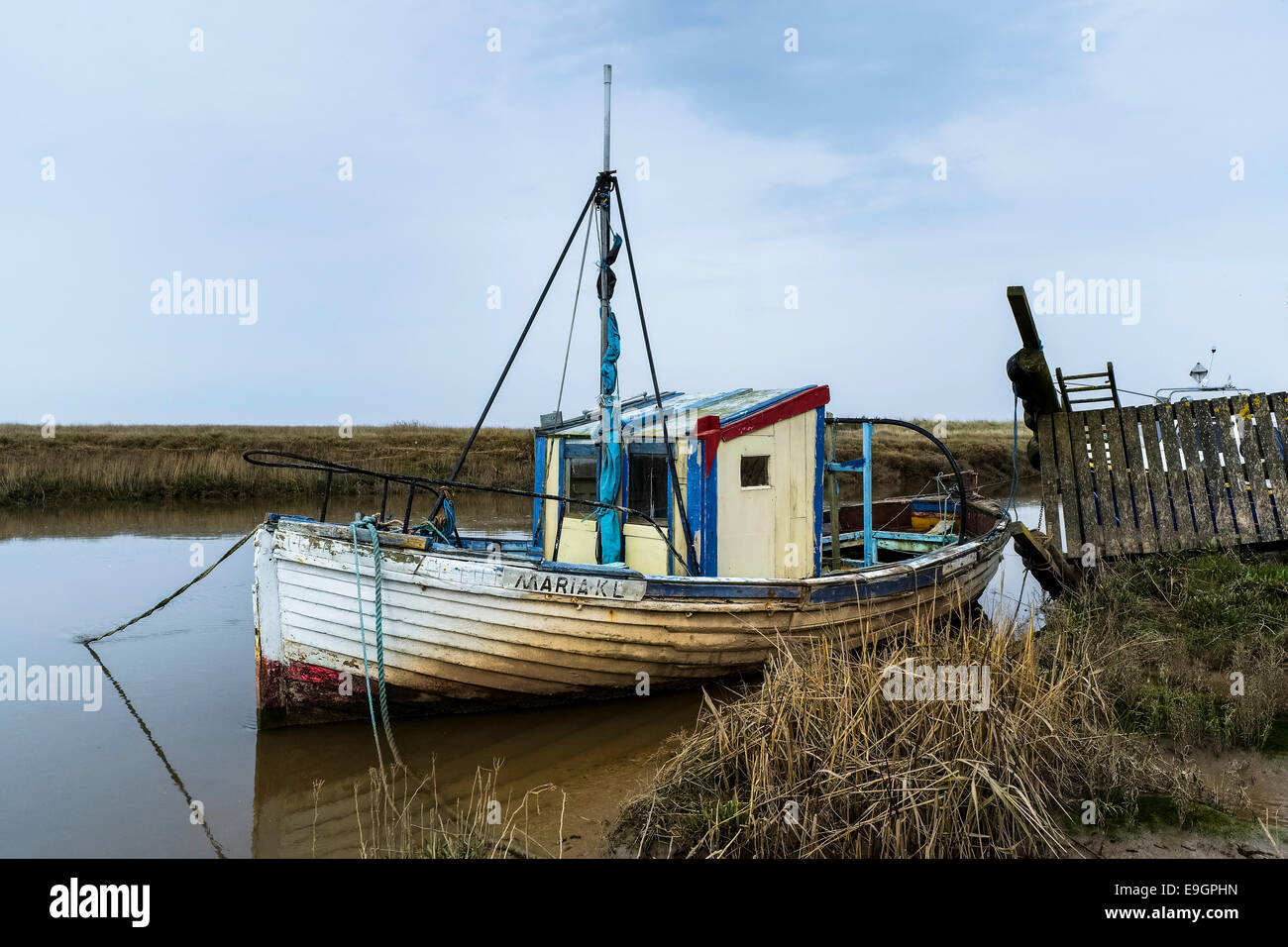 A fishing that has seen better days. - Stock Image