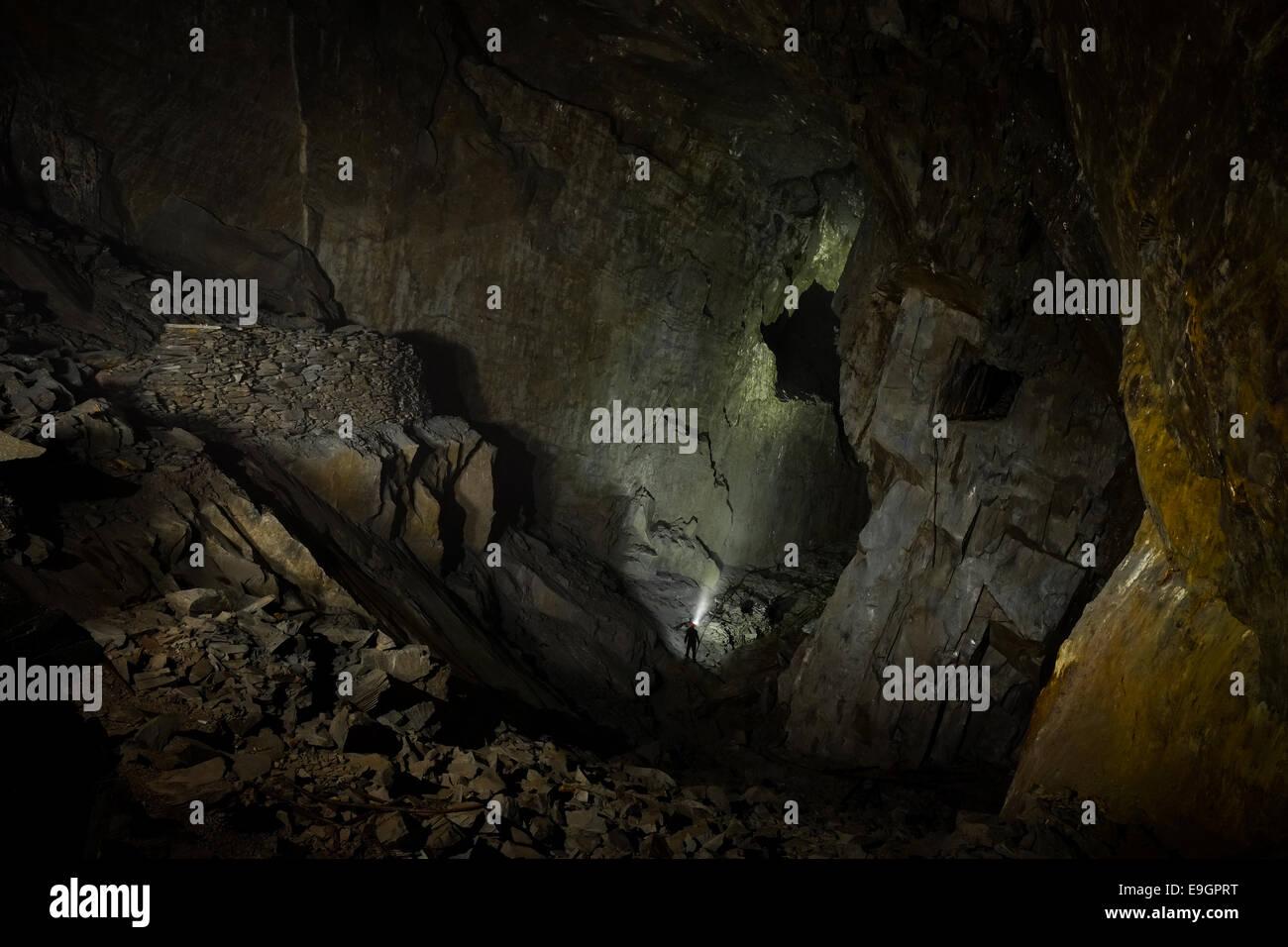 Exploring Moss Head slate mine, Coniston, Cumbria UK - Stock Image