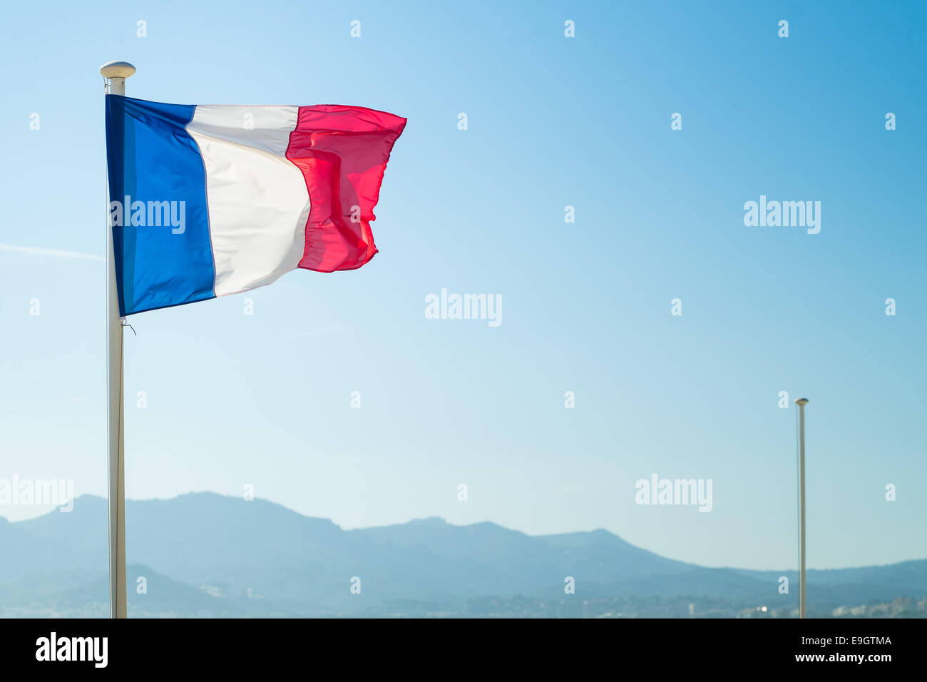 French flag flown on the beach in Cannes - Stock Image