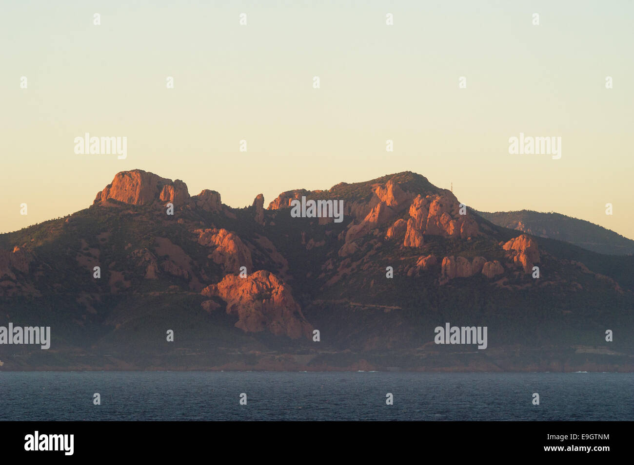 Mountains on the coast near Cannes, France, at sunset - Stock Image