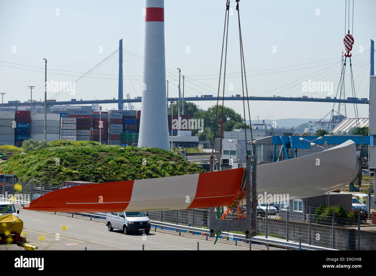 GERMANY Hamburg, truck transport rotor blade for new Nordex wind turbine from harbour to construction site, behind - Stock Image