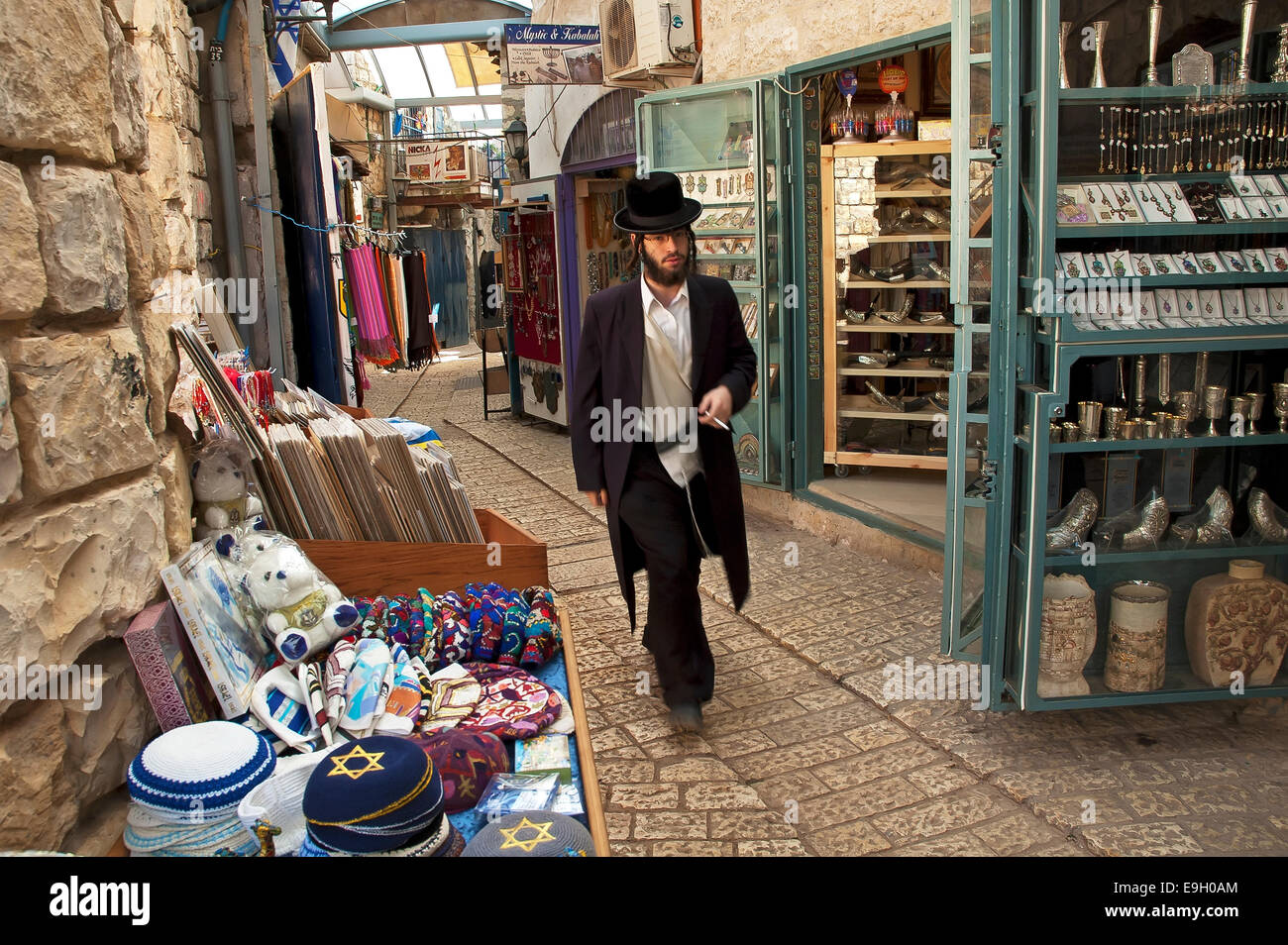Religious men walks in Safed old city Alley - Stock Image