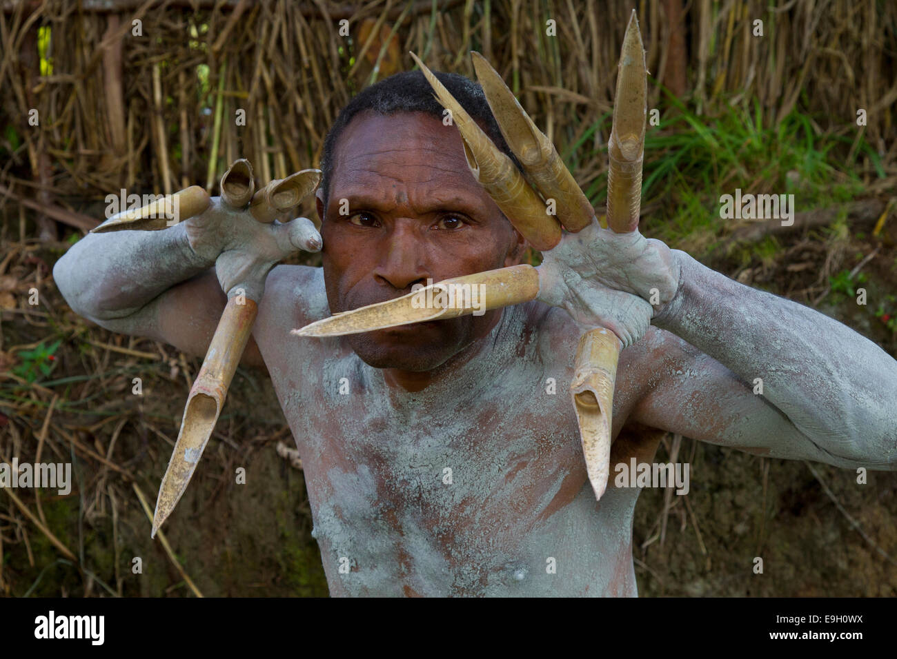 Mudman without Mask Shows his Claws - Stock Image