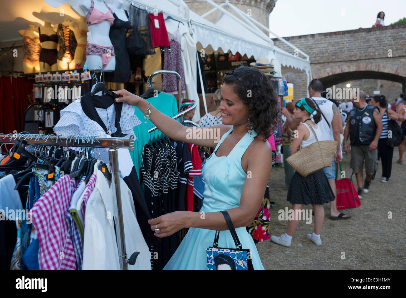 Woman shopping at the Summer Jamboree Rock'n'Roll Festival, historic center, Senigallia, Province of Ancona, - Stock Image
