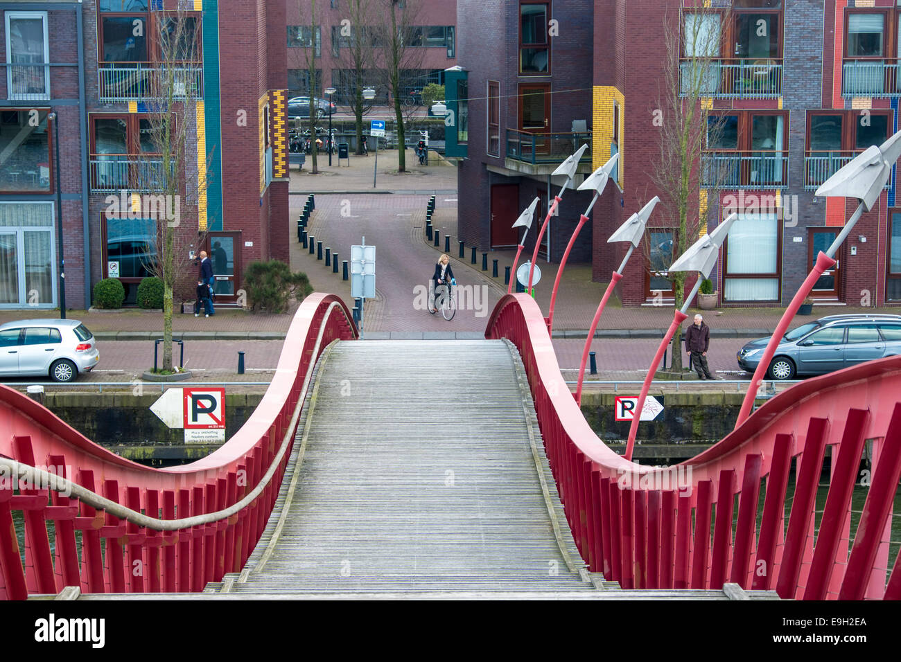 Red bridge between Borneo Eiland and Sporenburg Eiland, Eastern Docklands, Amsterdam, province of North Holland, - Stock Image