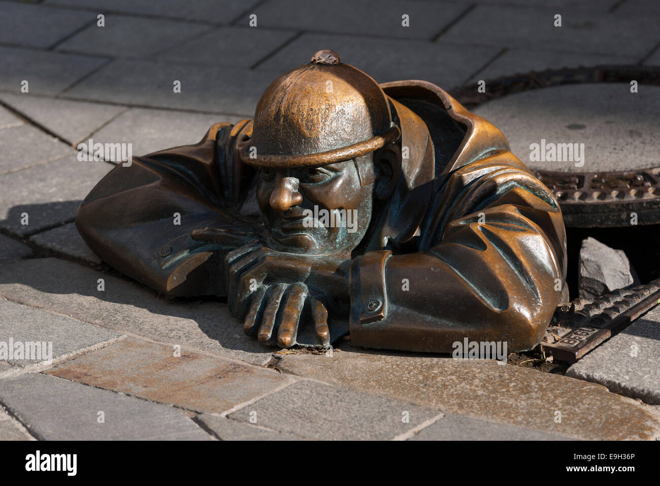 Quot man at work sculpture in a manhole cover by viktor
