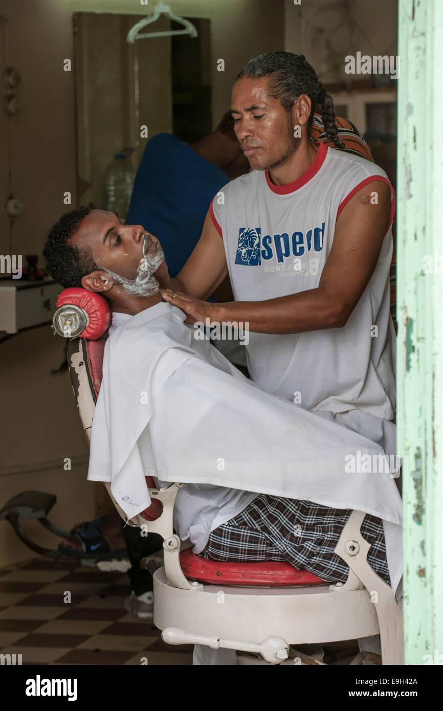 Barber at work, Mindelo, São Vicente, Cape Verde Stock Photo