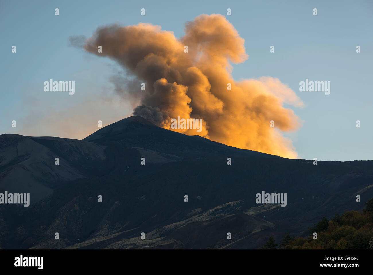 Eruption cloud in the evening light above the new northeast crater, north side, Mount Etna, at Mascali, Sicily, - Stock Image
