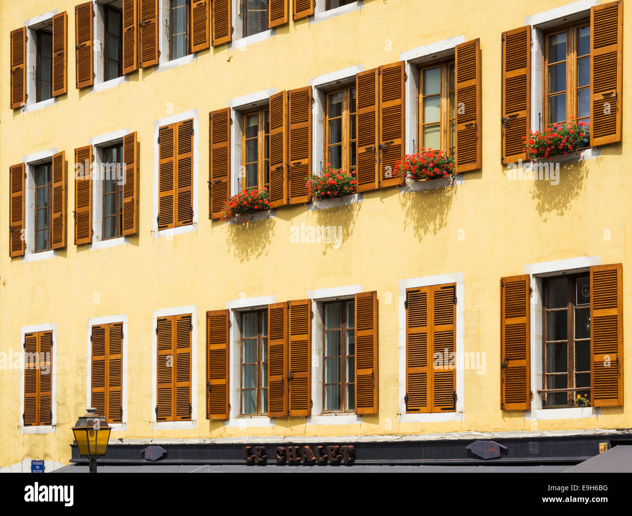 Row of shuttered windows on apartments in a French city - Stock Image