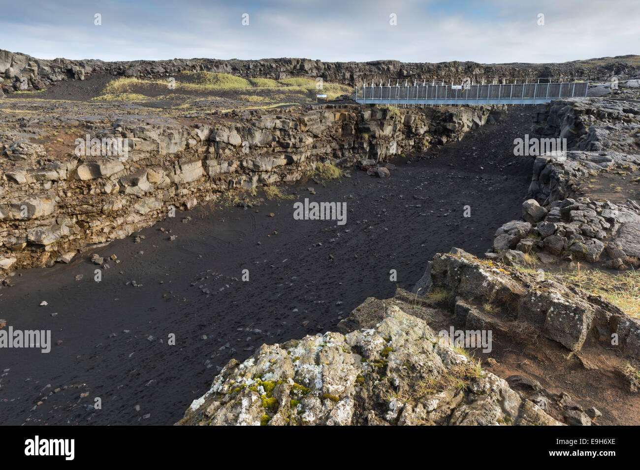 Bridge between the continents crosses the fracture zone between the American and European tectonic plates - Stock Image