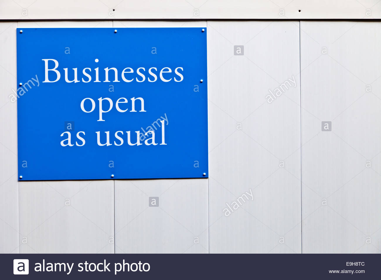Road works sign: Businesses Open As Usual. Concept business metaphor - Stock Image
