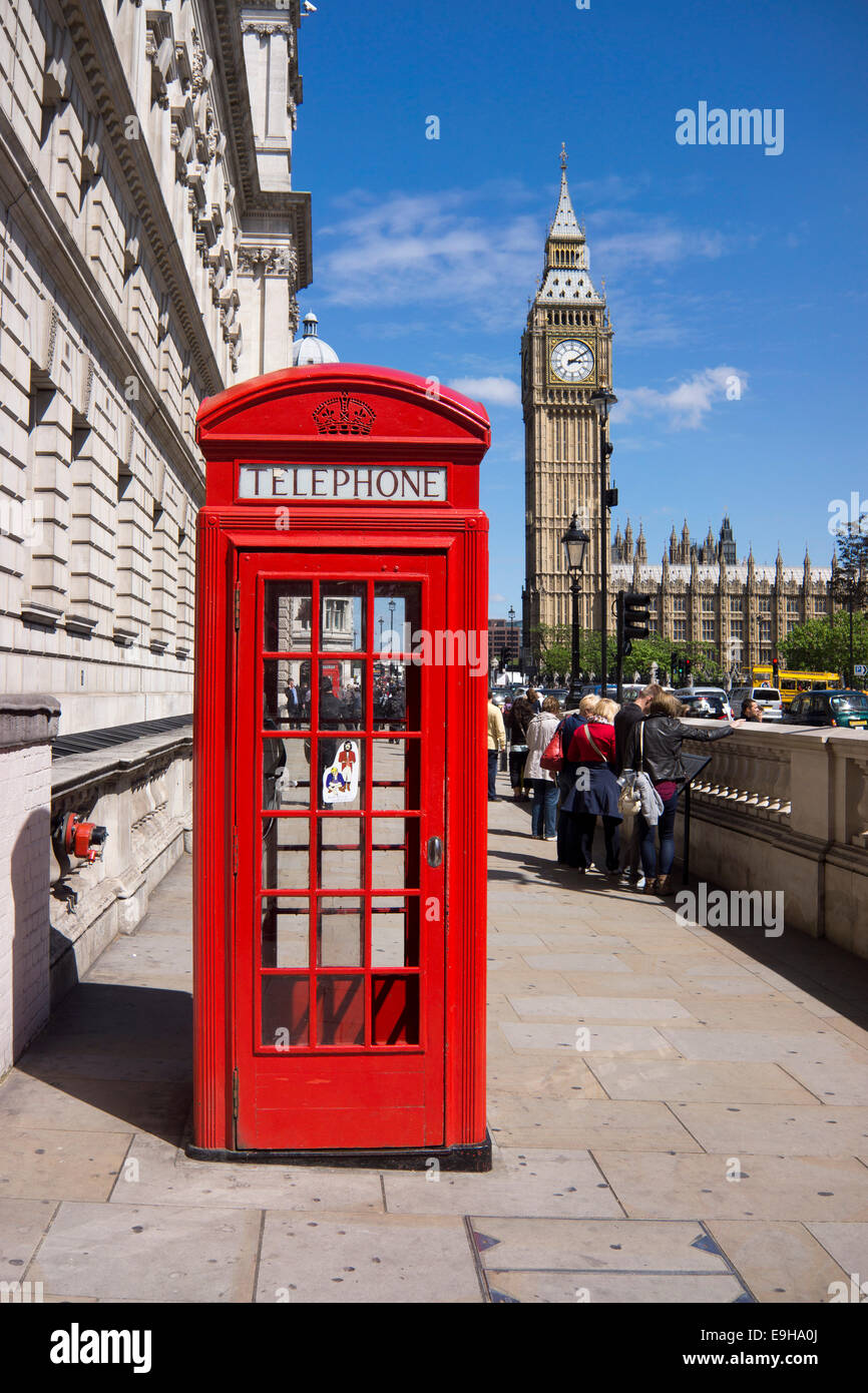 Red telephone box, Big Ben or Elizabeth Tower at back, London, London region, England, United Kingdom - Stock Image