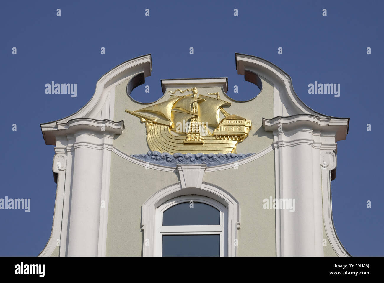 Representation of a Hanseatic cog on a merchant's house, Lübeck, Schleswig-Holstein, Germany - Stock Image