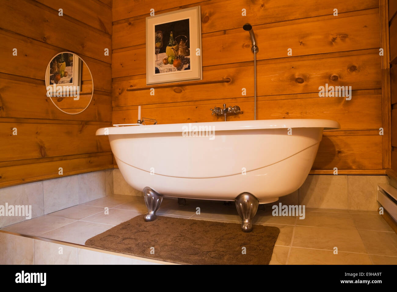 Roll Top Bath In A Bathroom Inside Canadiana Cottage White Pine Log Home Quebec Province Canada