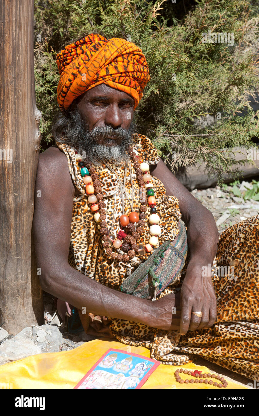 Sadhu, holy man with turban and necklaces, Muktinath, Mustang, Nepal - Stock Image