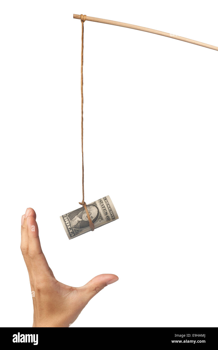 Using money as a bait depicting greed, isolated on white background - Stock Image