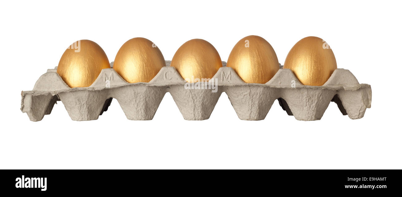 Tray of golden eggs isolated on white background - Stock Image