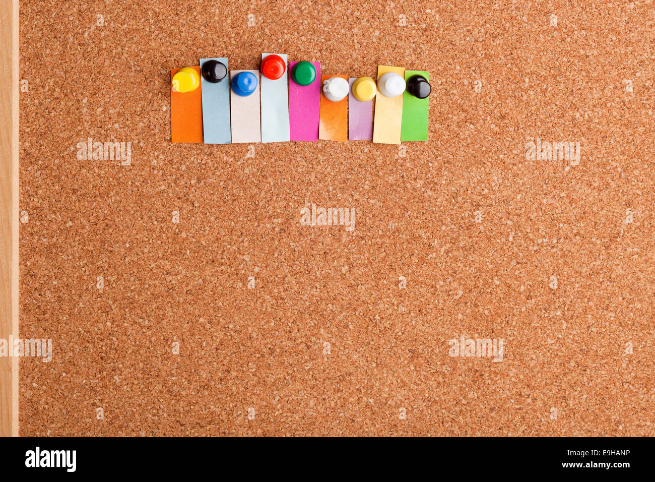 cork board and colorful heading with copyspace for a nine letter word