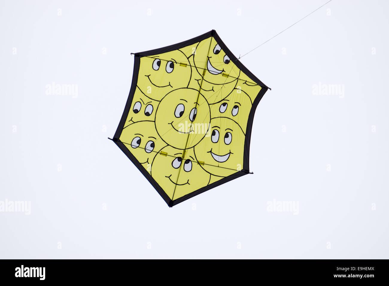 Smiley-kite on a kite-festival - Stock Image