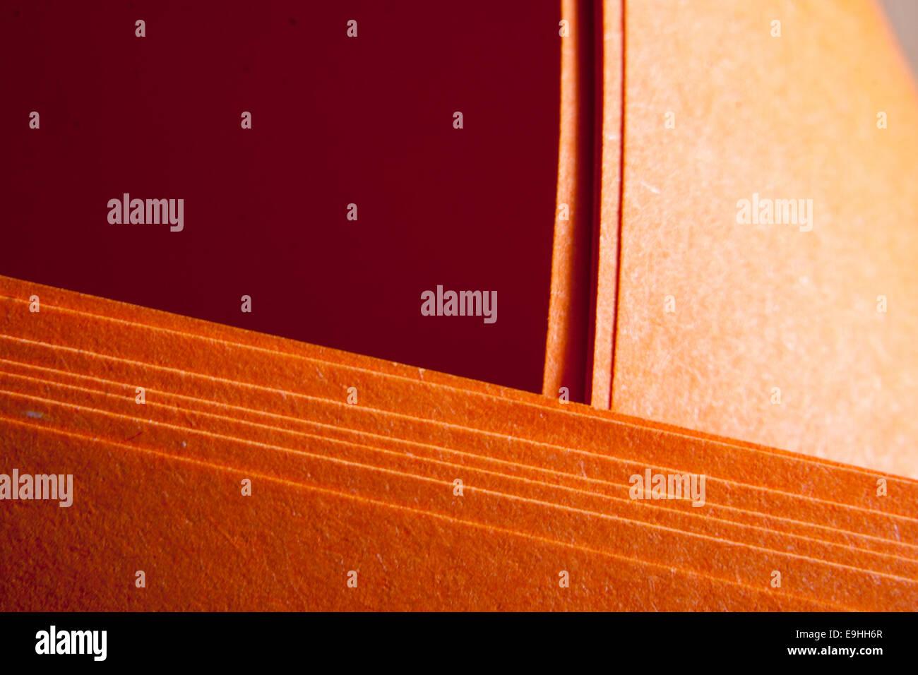 Grungy orange paper folds - Stock Image