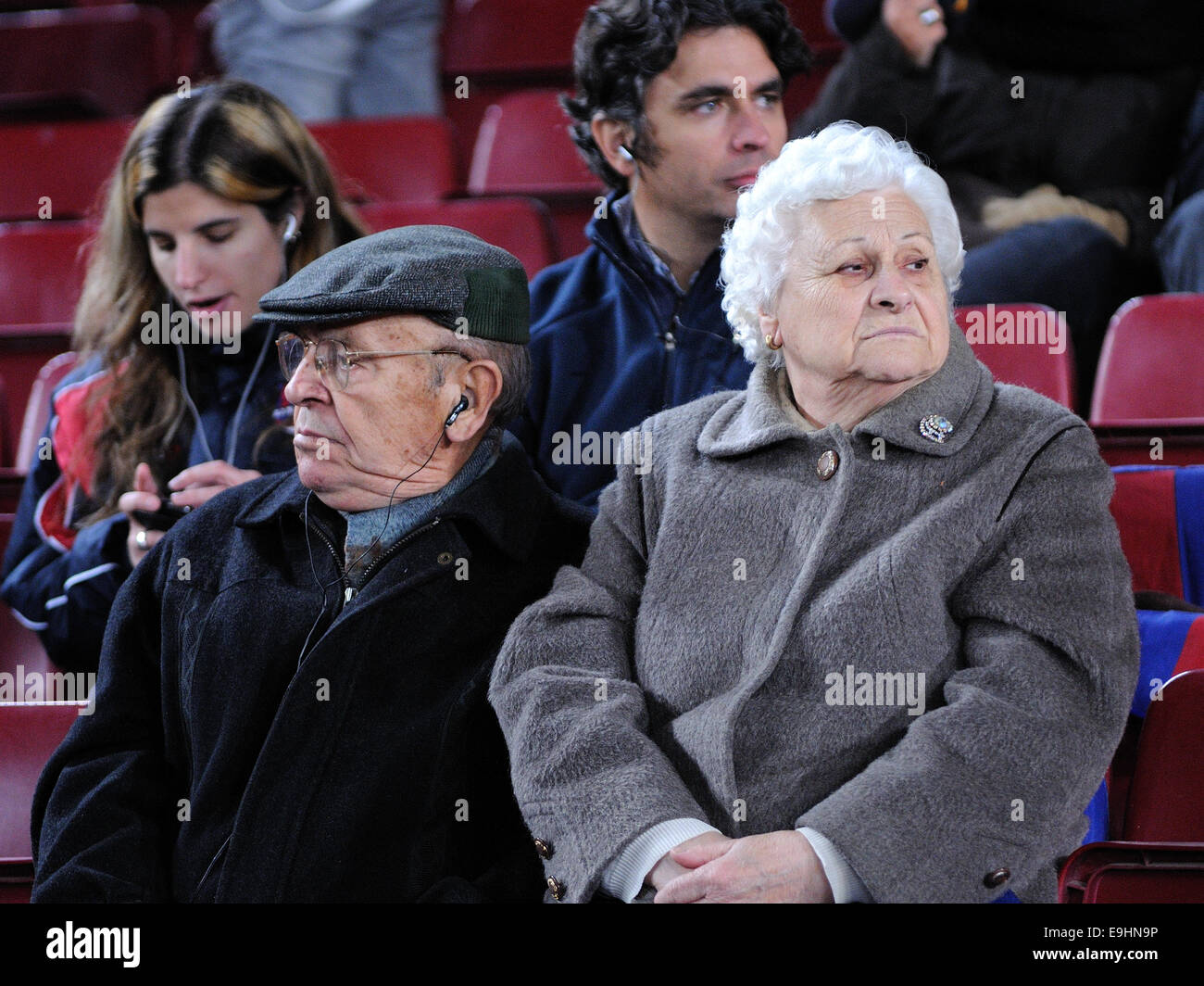 BARCELONA - NOV 10: Two old men watch a football match at the Camp Nou Stadium on the Spanish Cup. - Stock Image