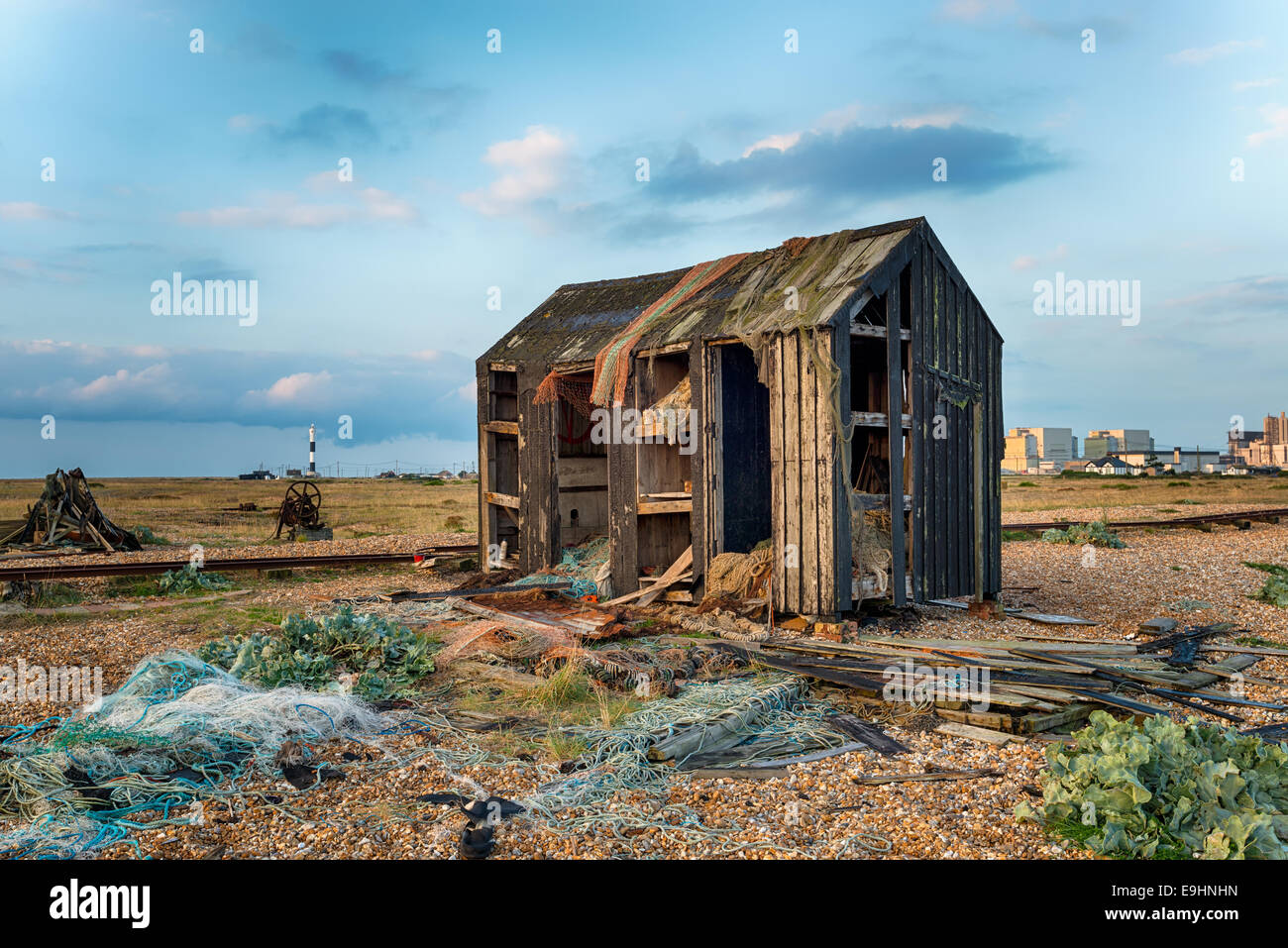 An abandoned fisherman's hut fallen into ruin and disrepair on Dungeness beach in Kent - Stock Image
