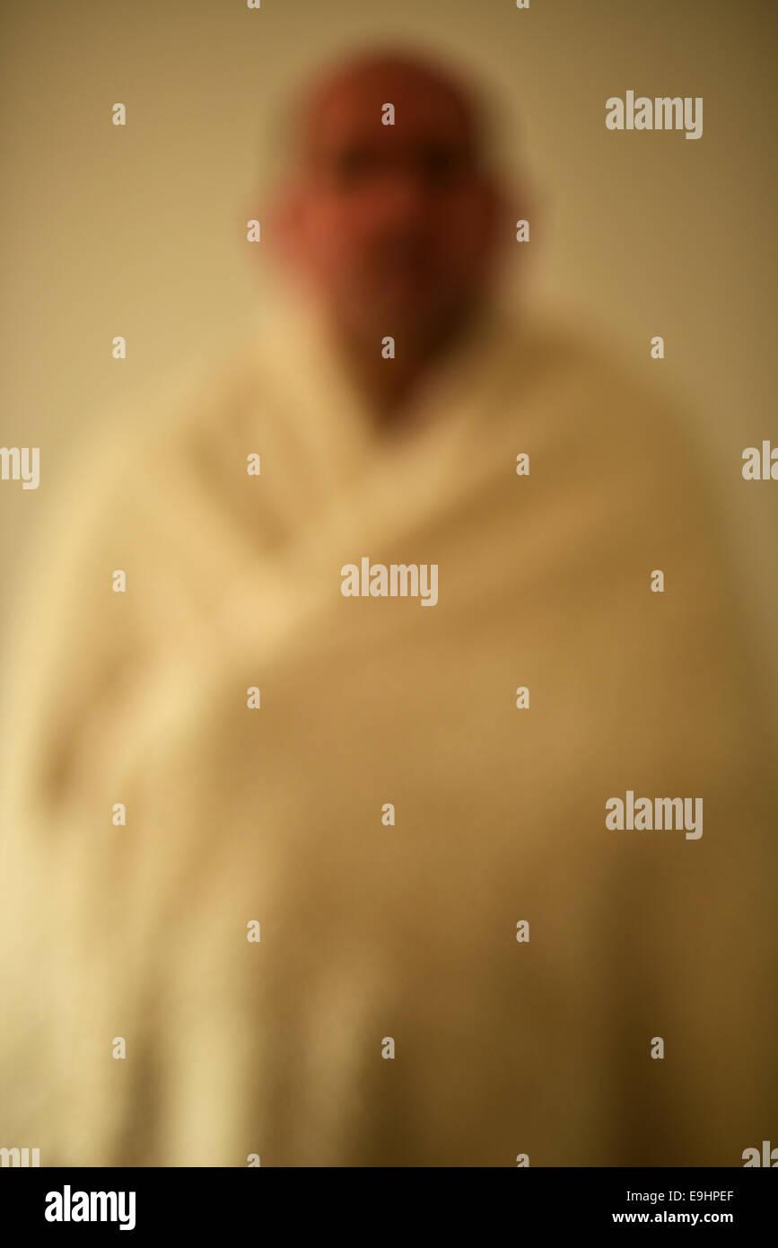 Man in white robe - Stock Image