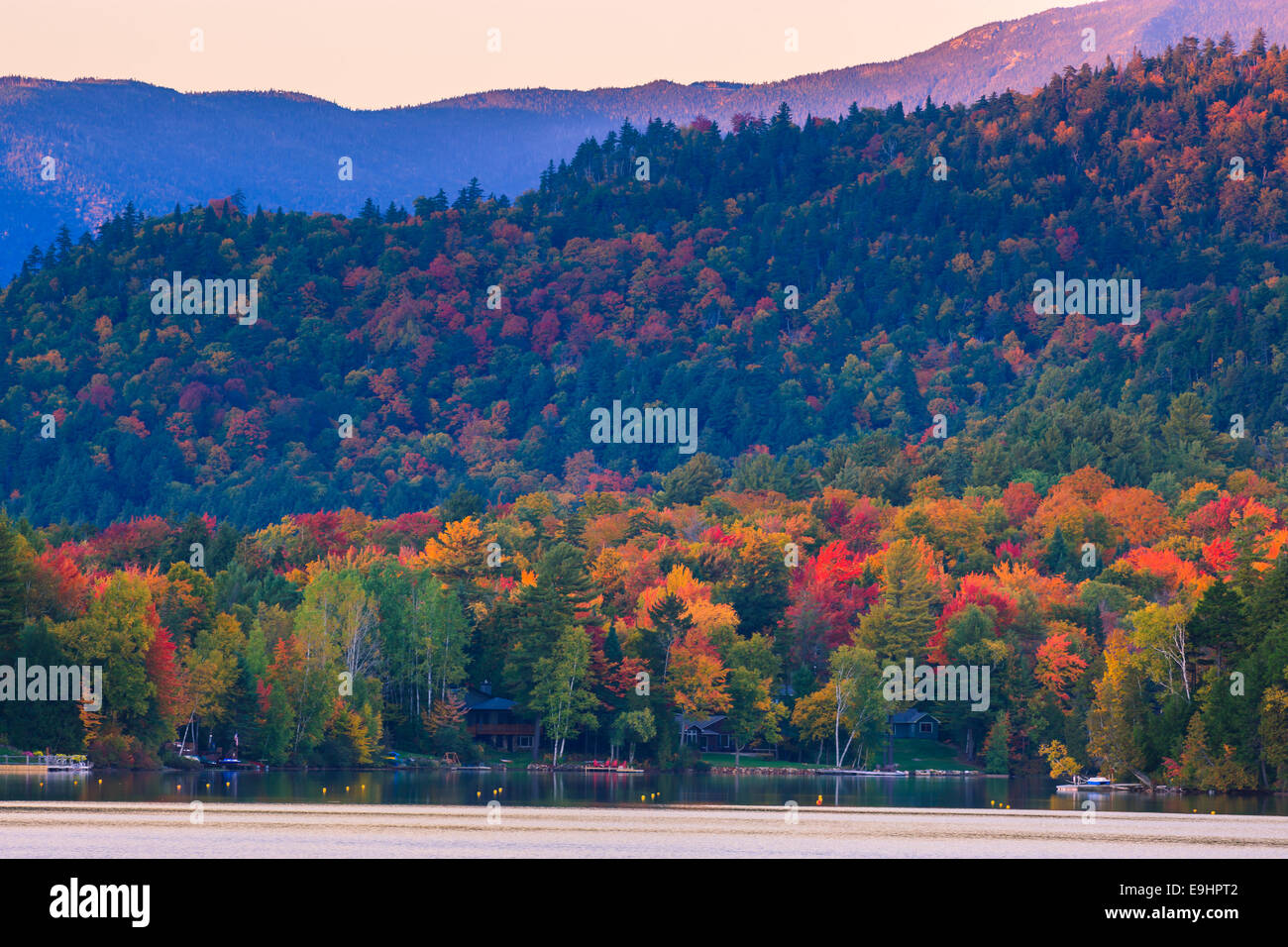 Autumn colors at Mirror Lake in Lake Placid in Adirondacks State Park in the northern part of New York State, USA - Stock Image