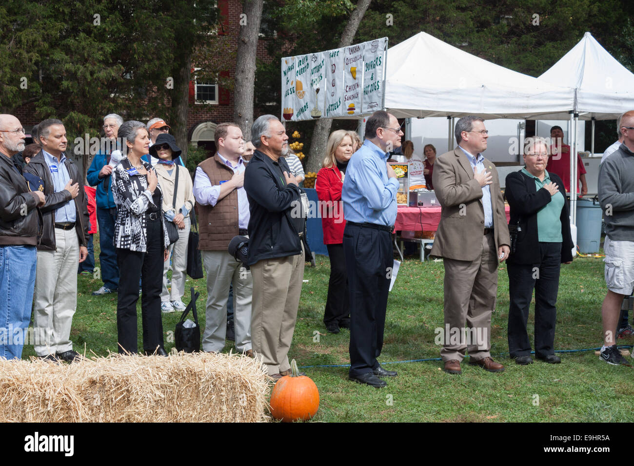 Dignitaries standing at attention for the National Anthem and Pledge of Allegiance, Gaithersburg, Maryland, Kentlands - Stock Image