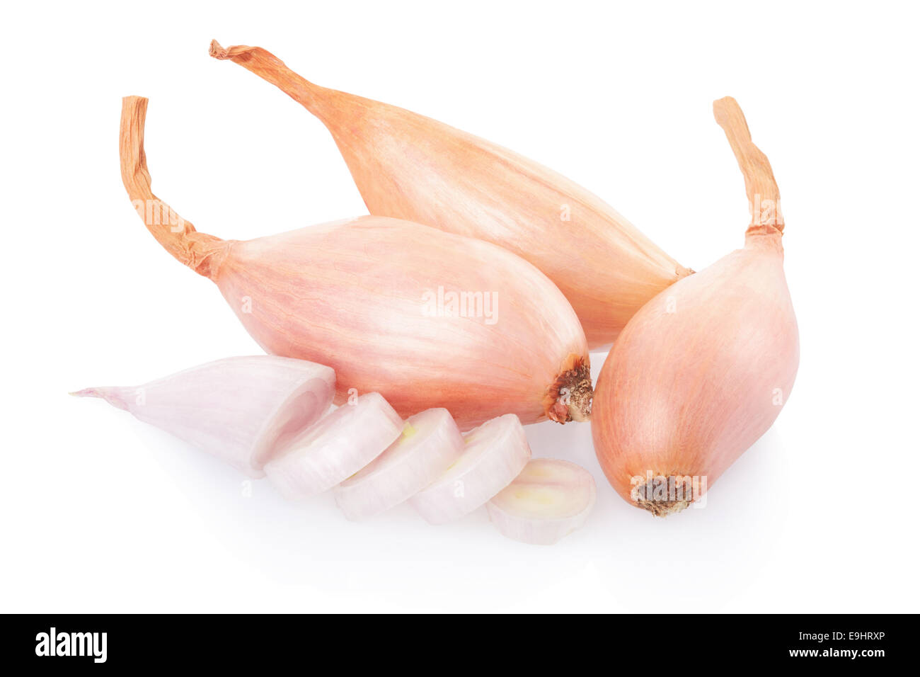 Shallot onions and slices isolated on white, clipping path included - Stock Image