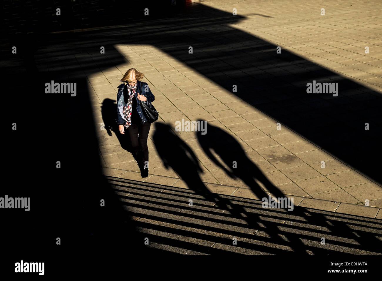 Basildon, Essex, UK. 28 October 2014.  Shoppers walking in unseasonal warm sunshine in Basildon Town Centre.  Photo: - Stock Image
