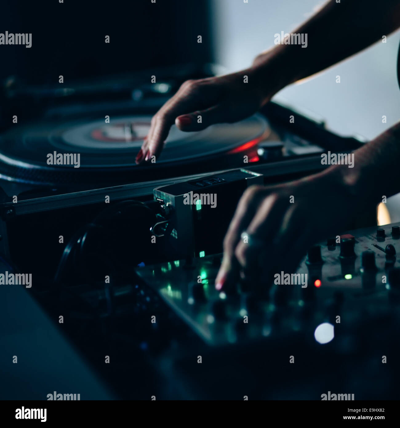 Female dj at work in night club. Shallow depth of field - Stock Image