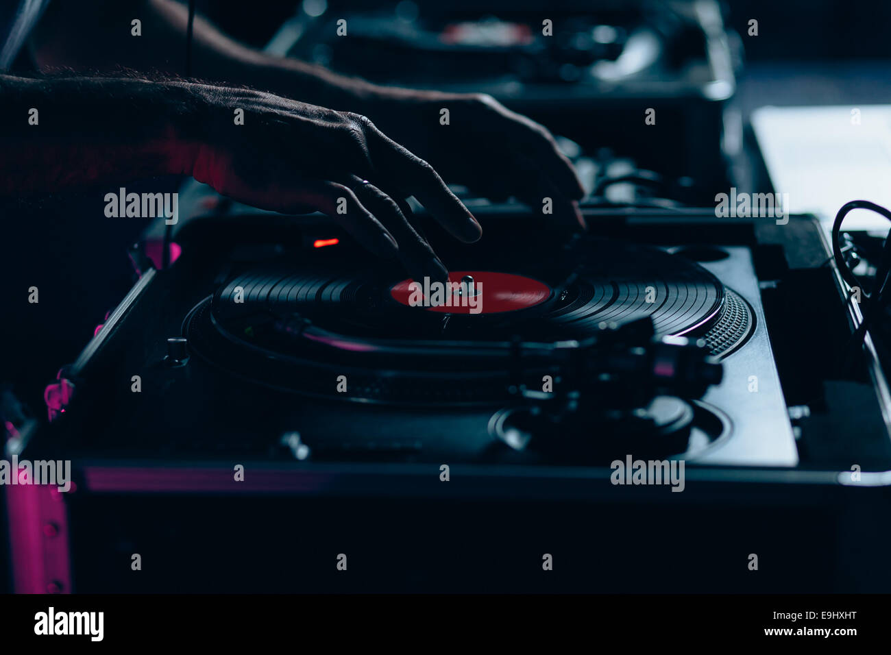 Male dj at work in night club. Shallow depth of field - Stock Image