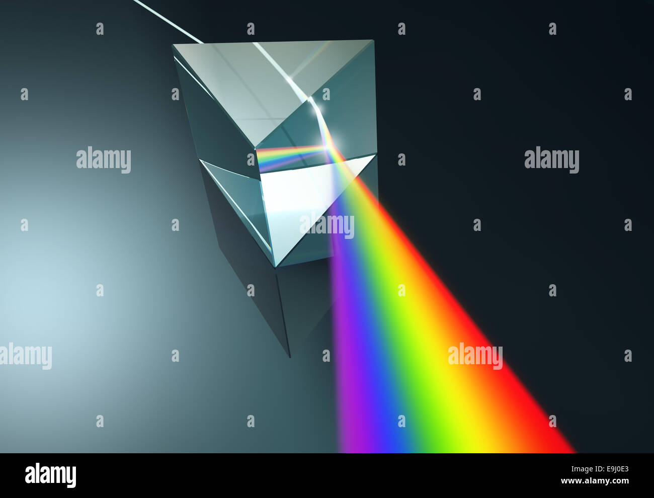 The crystal prism disperses white light into many colors. - Stock Image