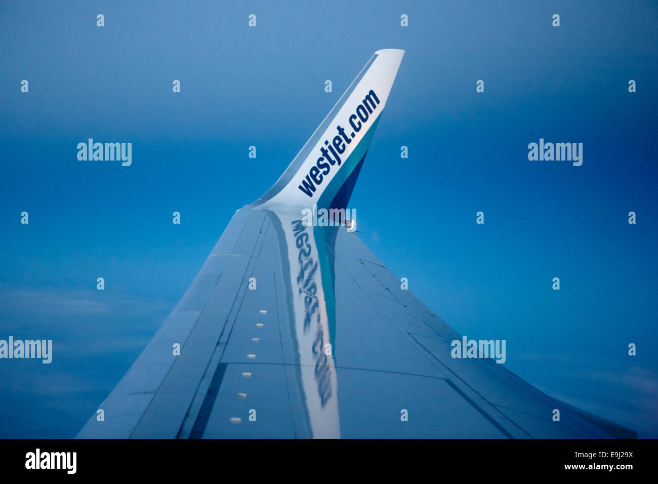 winglet on a boeing 737-800 westjet aircraft flying over Canada. The winglets increase life, improve fuel efficiency - Stock Image