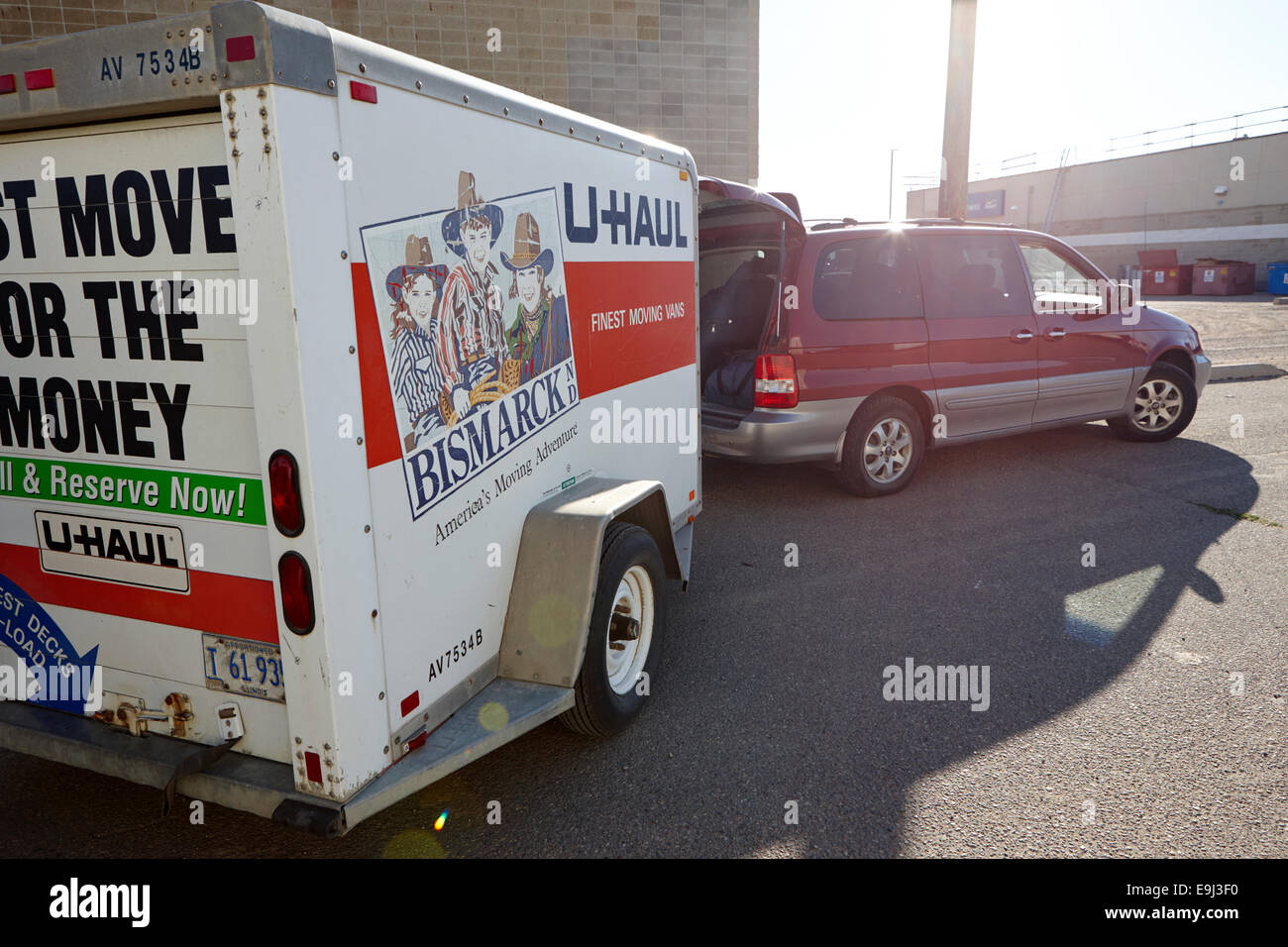 mpv van with u-haul trailer attached in Canada - Stock Image