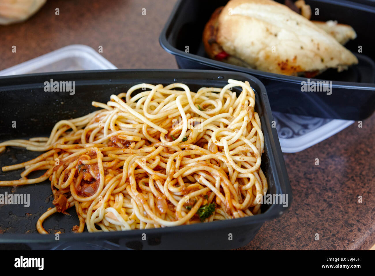 boxed leftovers of spaghetti and sandwich from a restaurant in Saskatchewan Canada - Stock Image