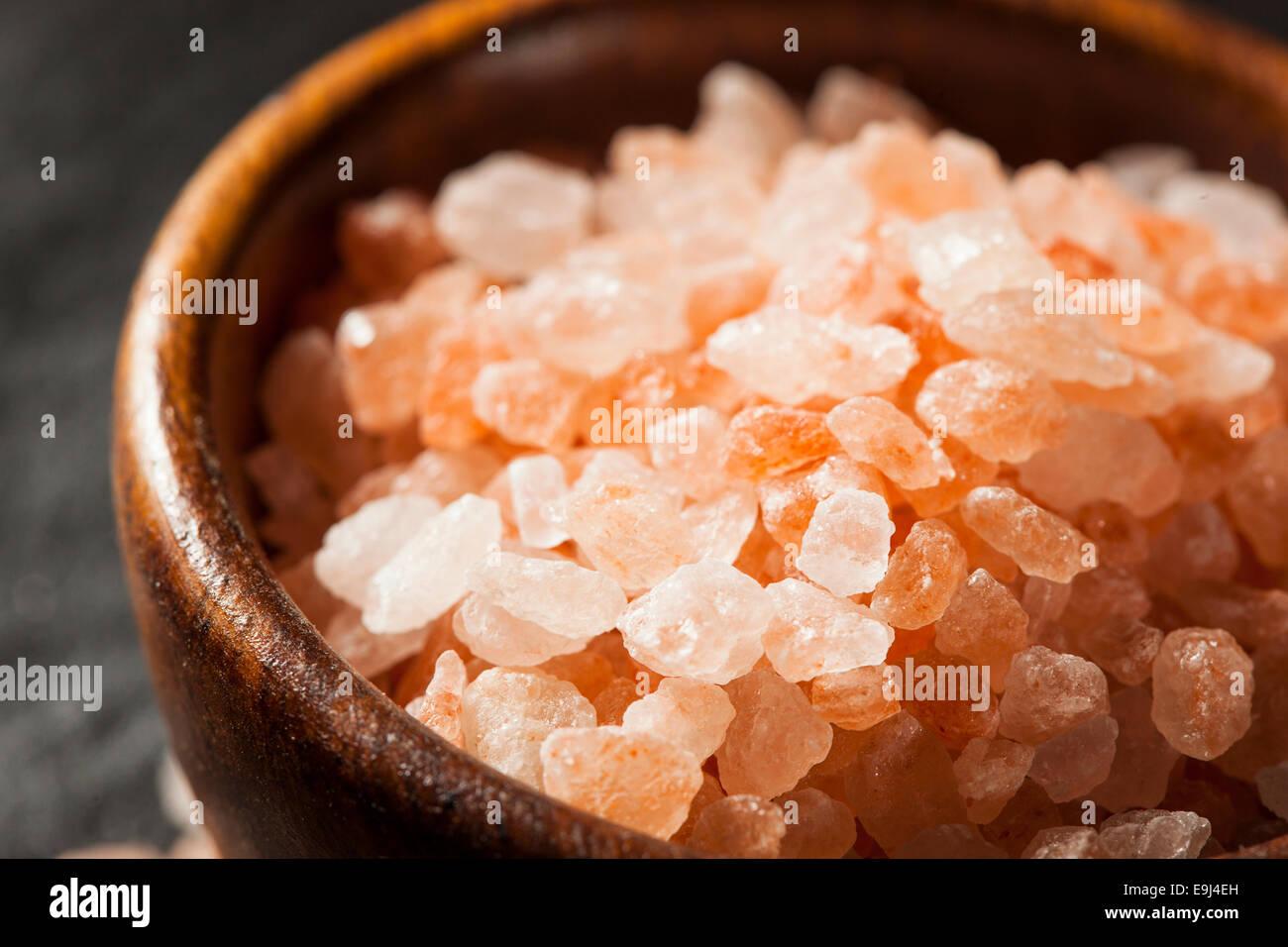 Raw Pink Himalayan Sea Salt in a Spoon - Stock Image